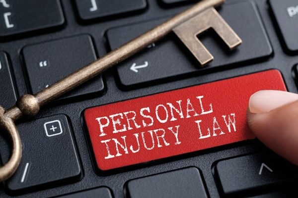 Personal Injury Law written on a red keyboard enter key